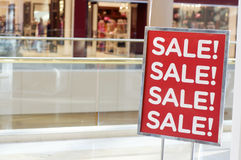 Sale sign outside store. In shopping mall Royalty Free Stock Photo