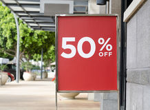 Sale sign outside store in shopping mall Royalty Free Stock Photography