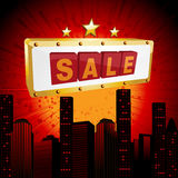 Sale sign over abstract cityscape Royalty Free Stock Photo