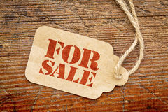 For sale sign  on a paper price tag Royalty Free Stock Image