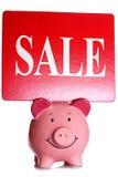 Sale sign and piggybank Stock Photos