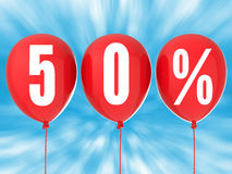 50% sale sign on red balloons. With blue background Royalty Free Stock Photography