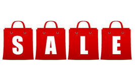 Sale sign in red in the form of packets with white Stock Image