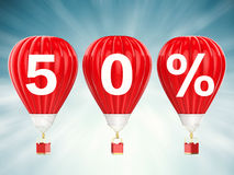 50% sale sign on red hot air balloons. 50% sale sign on 3d rendering red hot air balloons Royalty Free Stock Photos