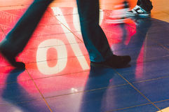 Sale sign reflected at feet of shoppers. Sales sign reflected onto floor at feet of walking shoppers Royalty Free Stock Photo