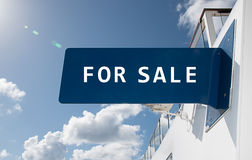 For Sale sign. Advertising concept: Sales text sign with blue and white colors. Sky background Stock Image