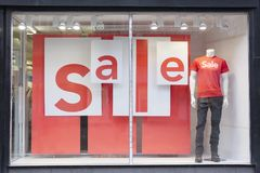 Sale Sign Shop Mall Window Male Mannequin. Shop mall window display sale sign discounted prices and male mannequin Royalty Free Stock Image