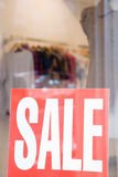 Sale sign in shop window Stock Photos