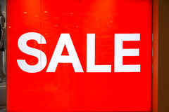 Sale sign on shop window Royalty Free Stock Photos