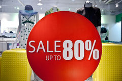 Sale sign on the storefront stock images