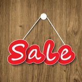 Sale sign on wood texture Stock Photos