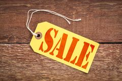 Sale sign on a yellow price tag Royalty Free Stock Photo