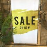 Sale signage in shopfront window Royalty Free Stock Photos