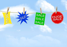 Sale signs. Hanging on a clothes line Stock Photos