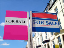 For sale signs. Two for sale sign in English street, with space for company names Royalty Free Stock Photo