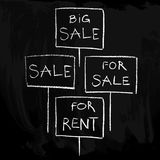 Sale signs on a chalkboard/set Royalty Free Stock Image
