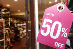 Sale signs in shop window Royalty Free Stock Photos