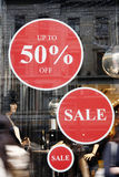 Sale signs in shop window Royalty Free Stock Photography