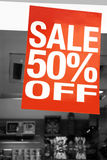 Sale signs in shop window Royalty Free Stock Image