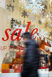 Sale signs in shop window, big reductions. Sale signs in shop window, Christmas, January, big reductions Stock Images