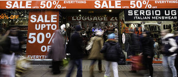 Sale signs in shop window, big reductions Stock Images