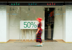 Sale signs in the shop window Royalty Free Stock Photography