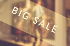 Sale signs in shop window Stock Photos