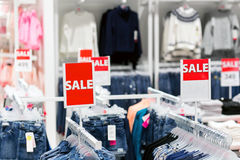 Sale signs in store - shopping concept royalty free stock photography