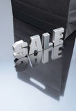 Sale silver text with paper bag Stock Photo