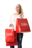 SALE - Smiling blond woman with sale bags Stock Photo
