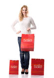 SALE - Smiling pretty woman with bags Sale Royalty Free Stock Photos