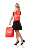 SALE - Smiling pretty woman with Sale bags Royalty Free Stock Image