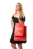 SALE - Smiling pretty woman with Sale bags Royalty Free Stock Photos