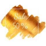 Sale 50% - smsa på guld- grön bakgrund Royaltyfri Foto