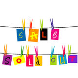 Sale and sold out hanging on a rope Royalty Free Stock Images