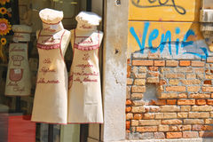 Sale of souvenir kitchen clothes in Venice, Italy Stock Images
