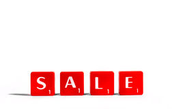 SALE. Spelt out with red lettered tiles over a white background Stock Photography