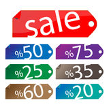 Sale Sticker Set. Vector illustrations of glossy/shiny retail icons with peel gradient effect with discount percentages from 20 to 75 + a sale element. In seven Stock Image