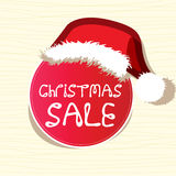 Sale sticker wears a Christmas hat Stock Photography