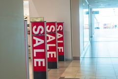 Sale in the store, a sign at the entrance the mall. Sale in the store, a sign at the entrance to the store in the mall Royalty Free Stock Photography