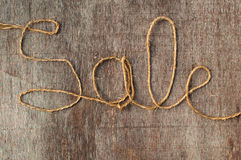 Sale string. Word Sale written with an old twine rope Stock Image