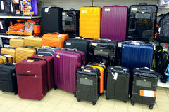 Sale of suitcases in the store. Large selection of bags for sale at the supermarket Stock Photo