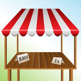 Sale table with stripped awning. Wooden Sale table with red and white stripped awning Stock Photo
