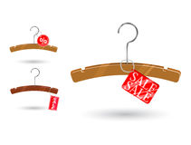 Sale tag attached to clothes hanger Stock Images