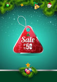 Sale tag on christmas background. Stock Photo