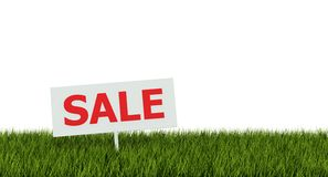 Sale tag on grass Royalty Free Stock Photos