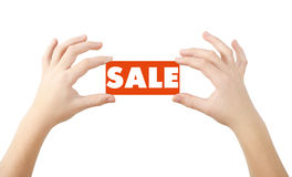 SALE tag. Hands holding SALE signature, clipping path on white background Royalty Free Stock Image