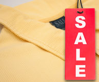 Sale Tag and Polo Shirt Stock Images