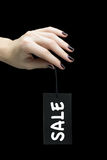 Sale Tag on women hand Royalty Free Stock Images