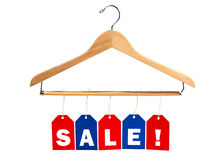 SALE tags on a clothes hanger Stock Photos
